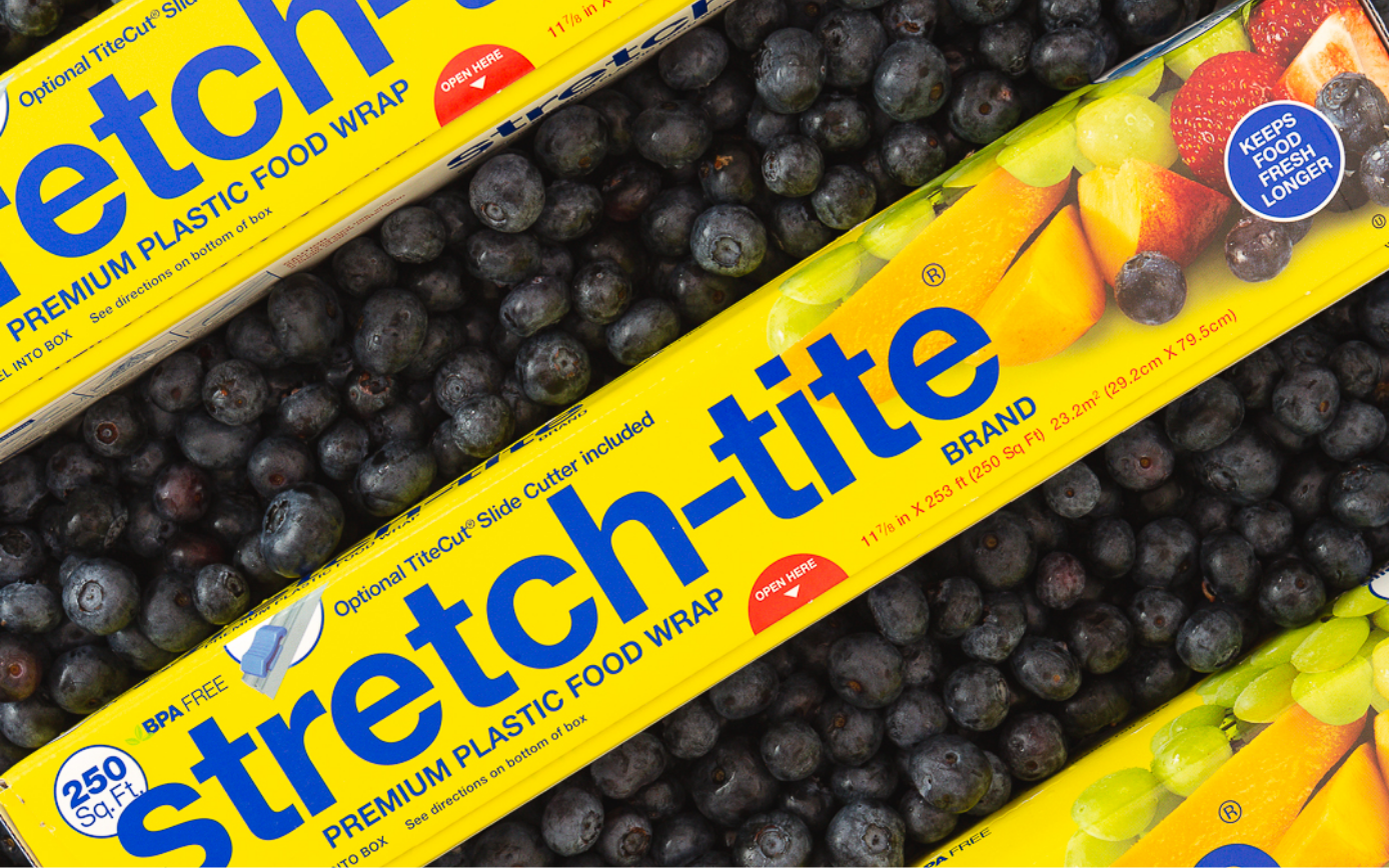 three boxes of yellow stretch-tite on blueberries